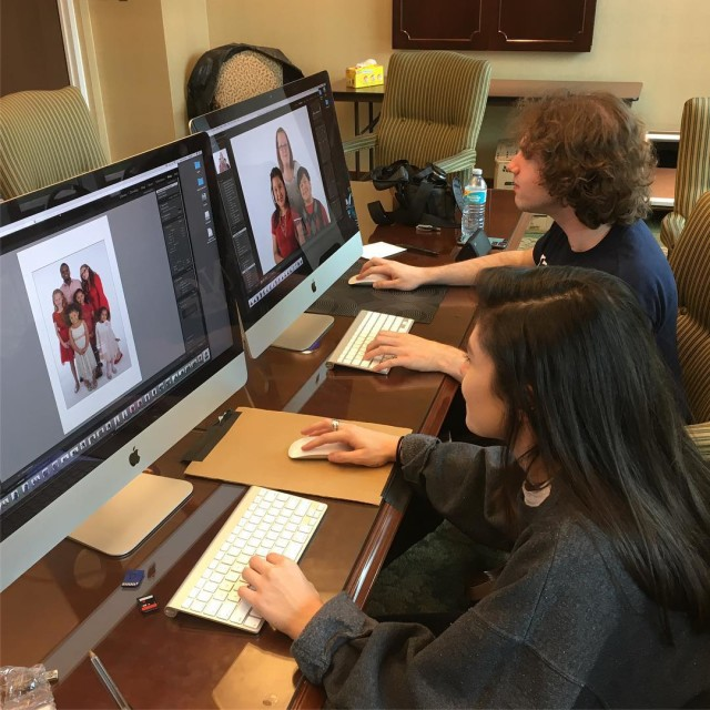 Two kingdmad students editing images for the Help Portrait eventhellip